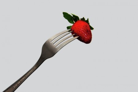 Fork and strawberries
